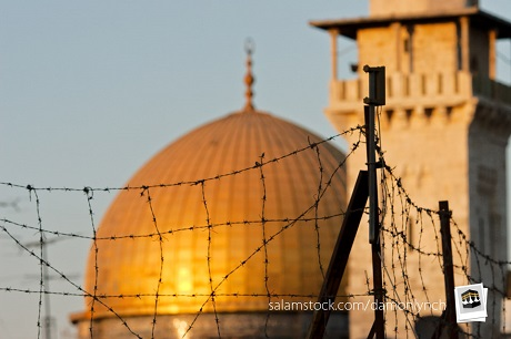 A barbed wire fence stands in front of Al Aqsa Mosque and the Dome of the Rock in Jerusalem on August 26, 2005.